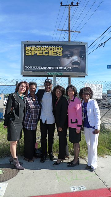 "Dr. Tolbert joins Walter Hoye (President of Issues4Life Foundation) and others in our ""Endangered Species"" abortion awareness campaign in California."